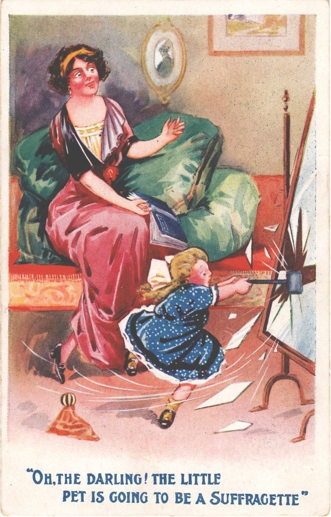 """A little girl destroying a mirror in front of her mother, with, """"Oh, the darling, the little pet is going to be a Suffrgatte:"""