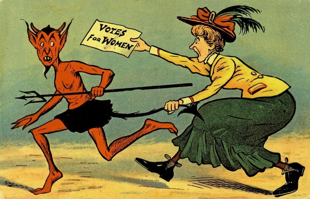 """A woman chasing the devil with a sign that says, """"Votes for women"""""""