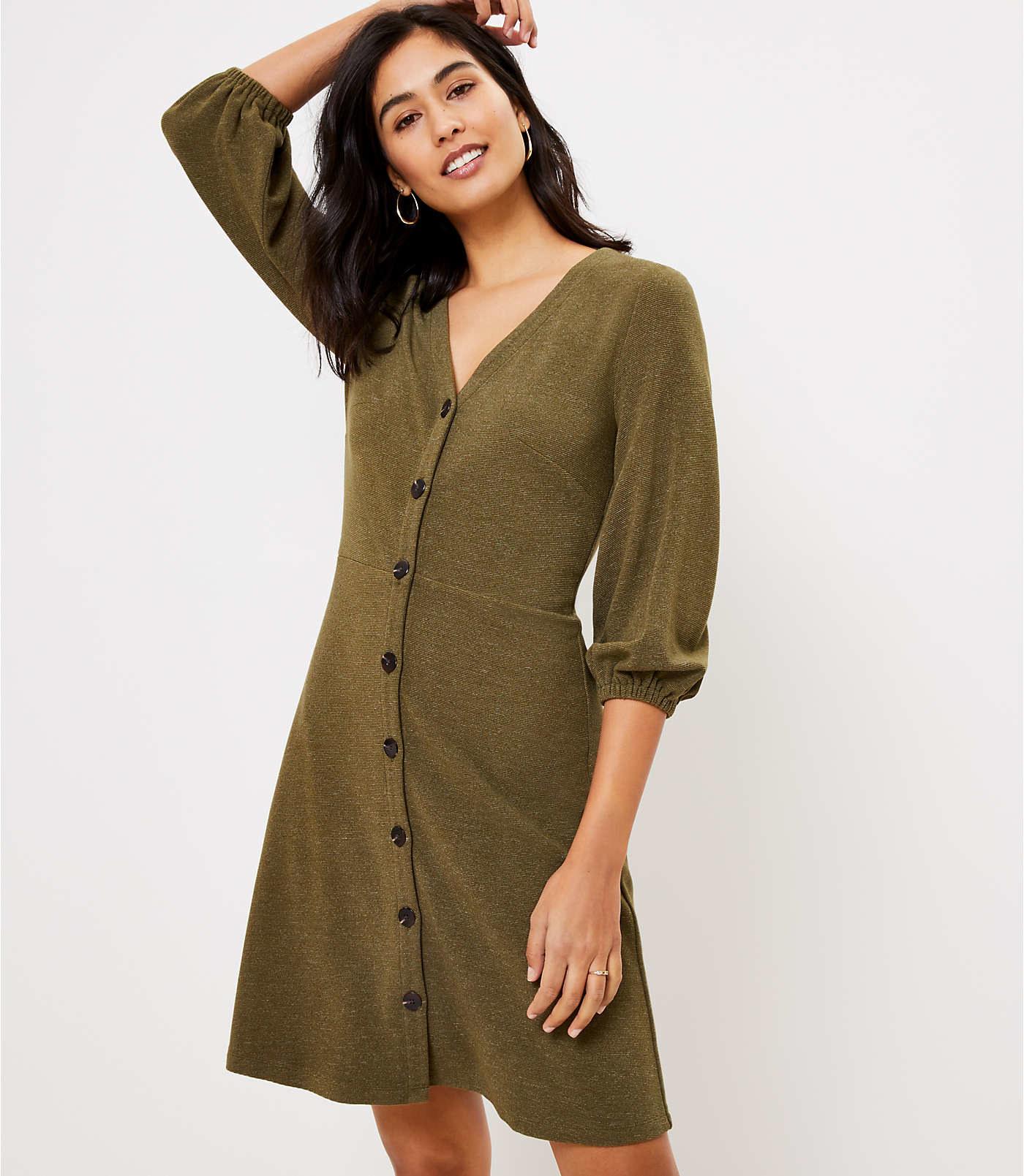 model wearing the V-neck green dress