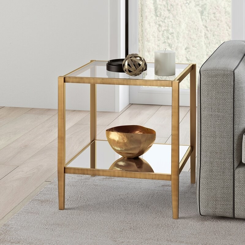 The end table in the color Antique Brass