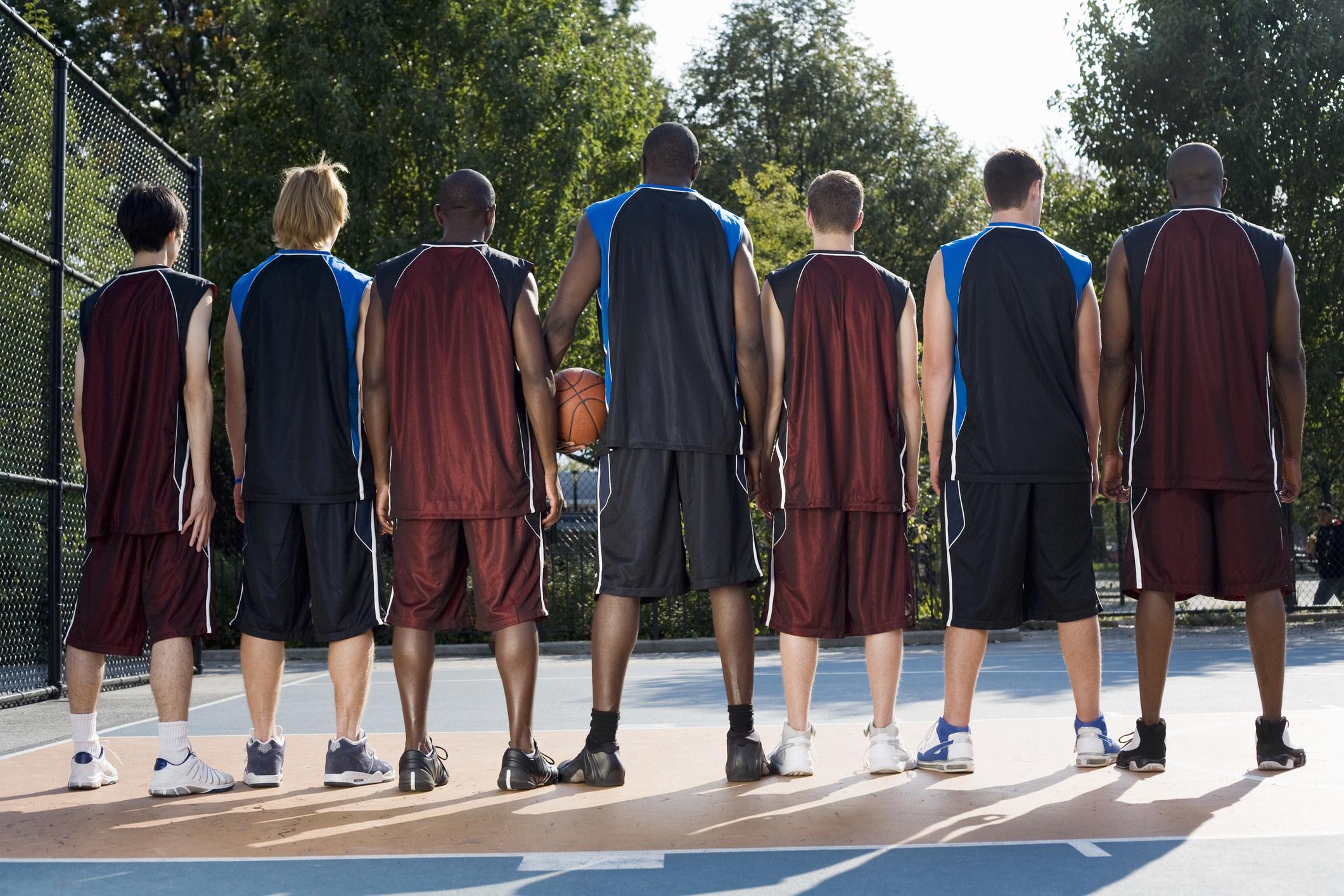 a lineup of tall basketball players