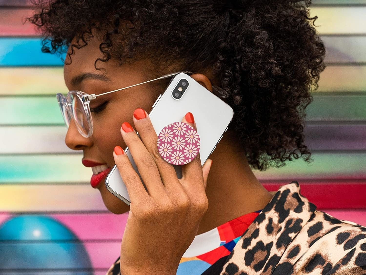 a model holding a phone with the pop socket