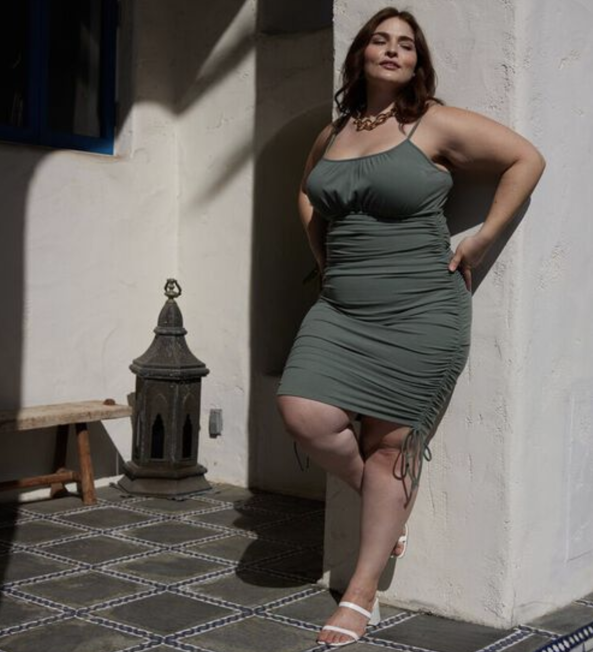 model wearing the green olive dress