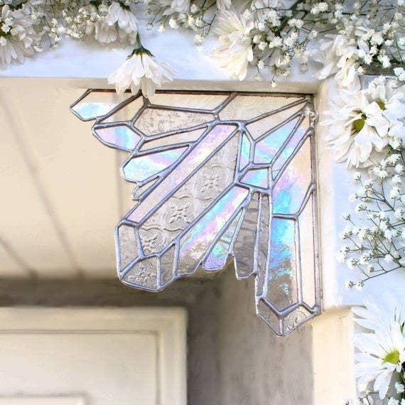 the stained glass corner piece on an outdoor entryway