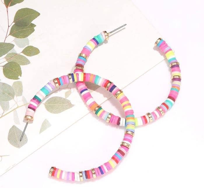 the rainbow colored hoop earrings