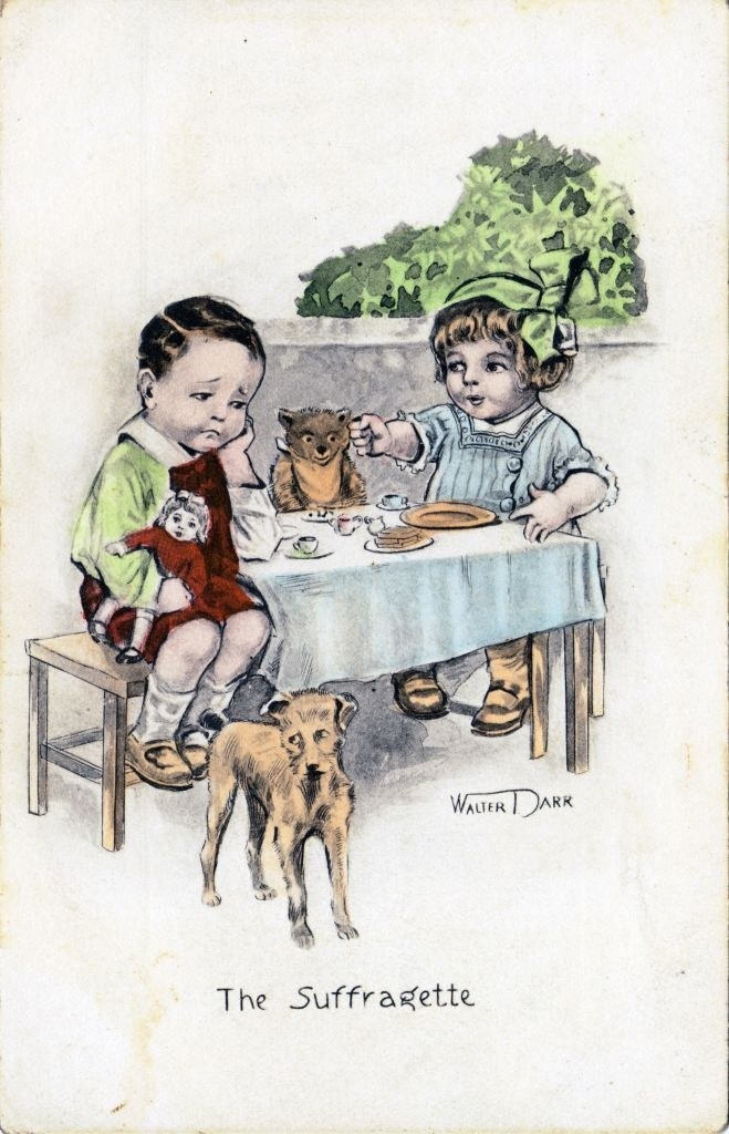 """A little girl directing a little boy, with """"The Suffragette"""" written beneath them"""