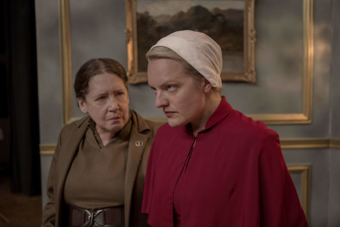 Still of Offred defying Aunt Lydia's orders