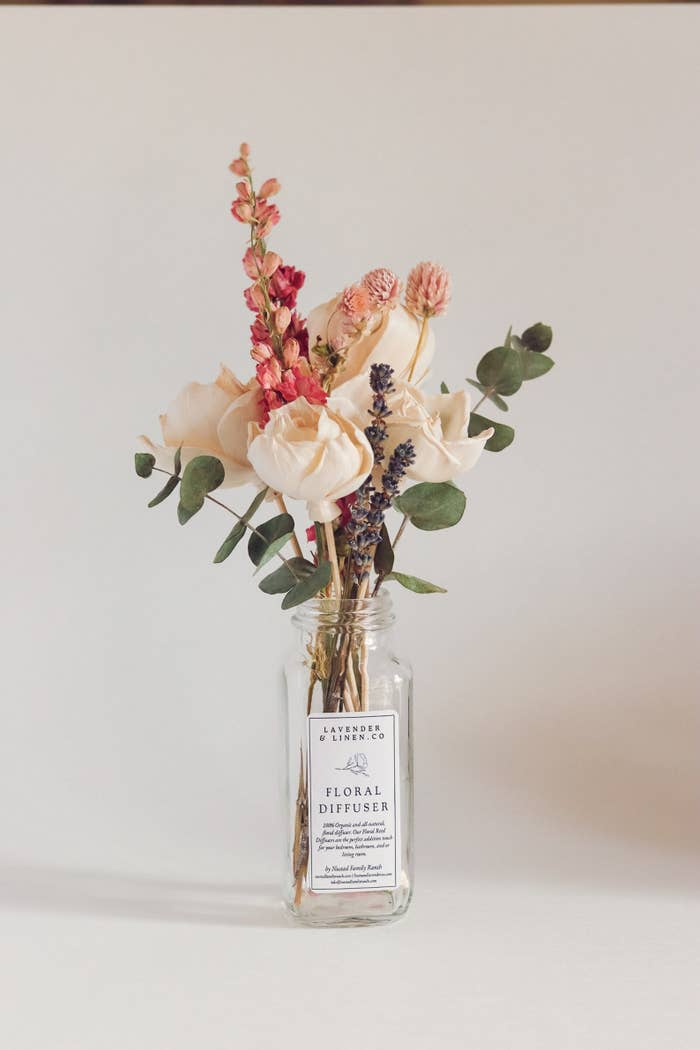 bouquet of dried flowers in a scented reed bottle