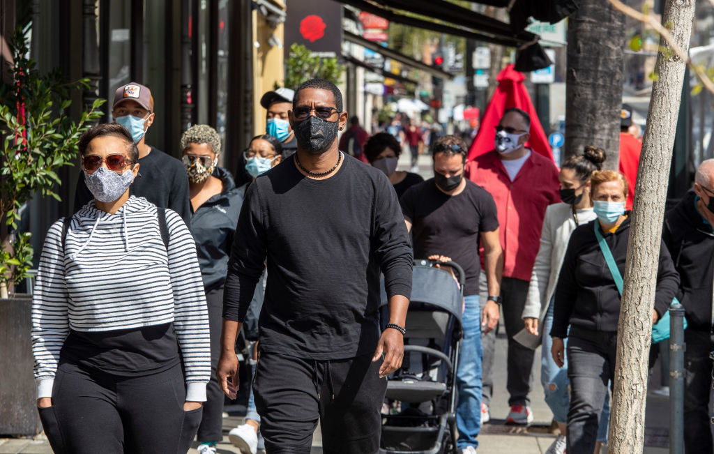 A lot of people walking in Pasadena but some people are wearing face masks