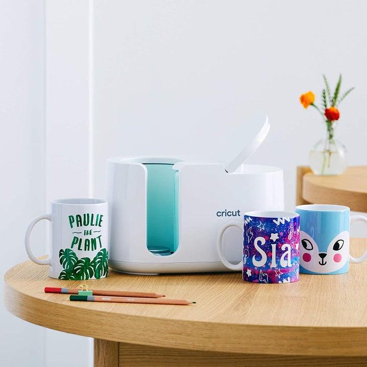 the white and blue cricut mug press machine