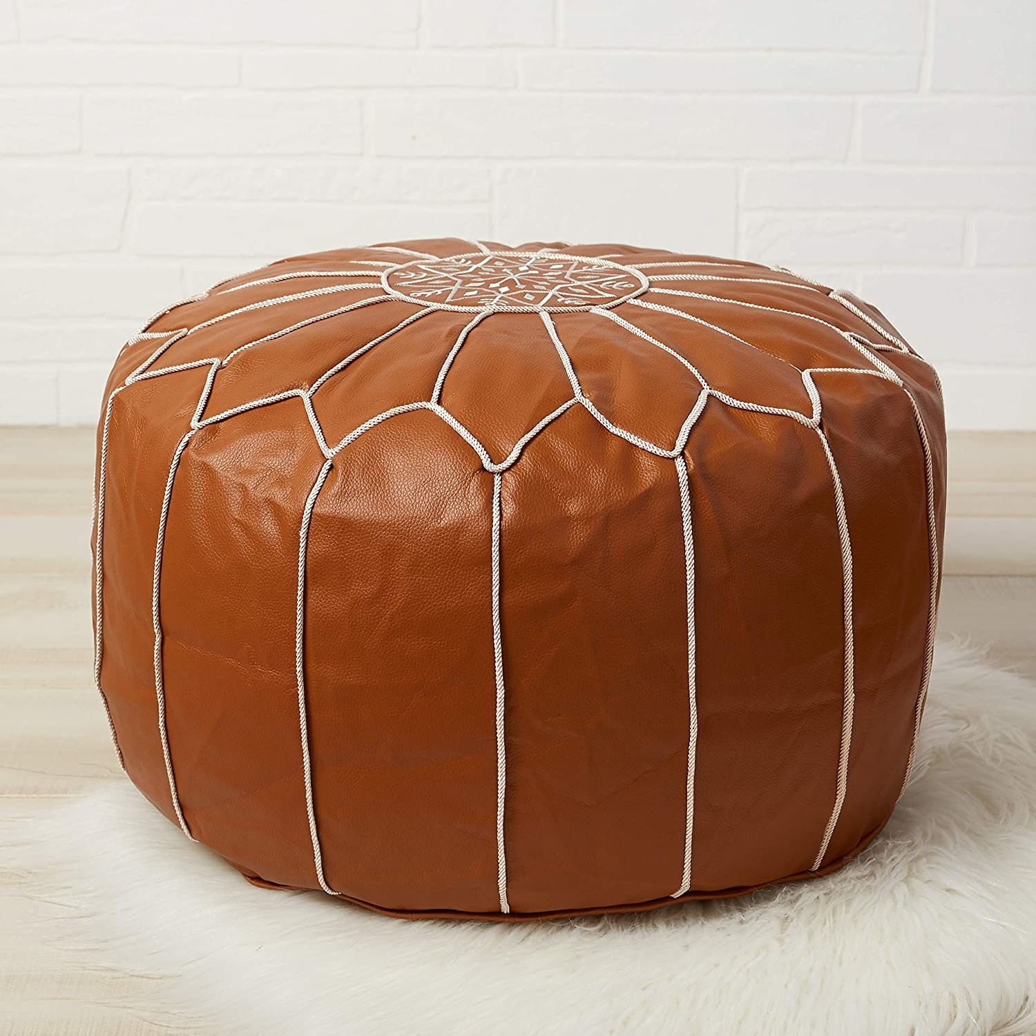 Red leather pouf with white cord details