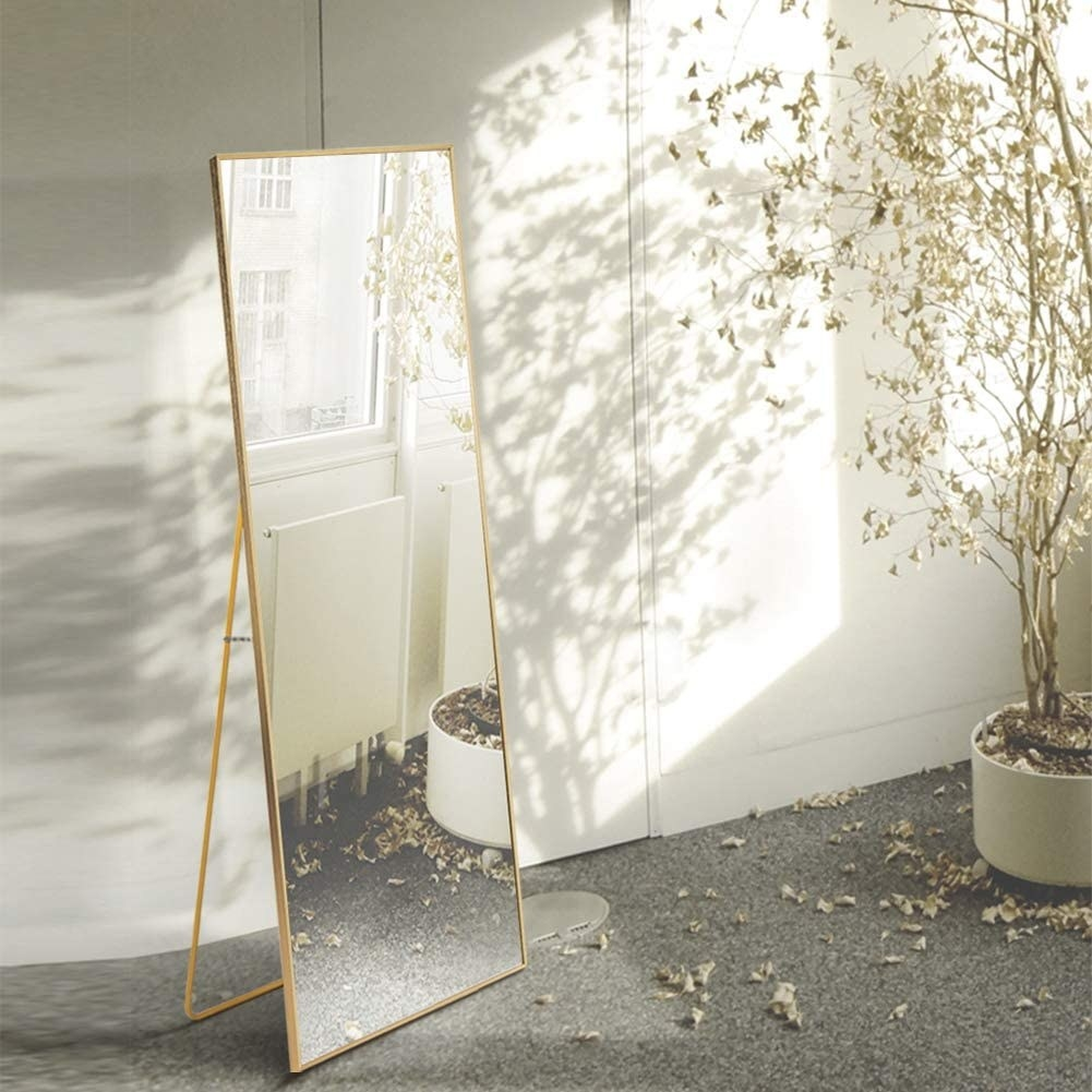 Rectangular mirror with thin gold edges and wire base