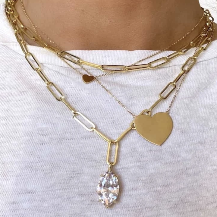 the bradshaw necklace stacked with other necklaces