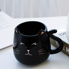 two mugs with cat ears and a tail as a handle