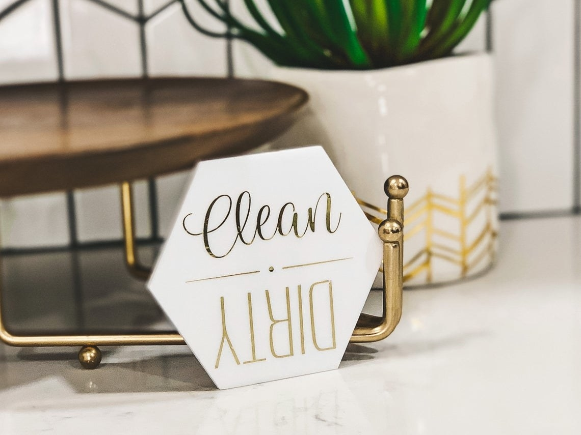 """hexagonal white plastic magnet that says """"clean"""" on one end and """"dirty"""" upside-down on the other, so you could rotate it"""