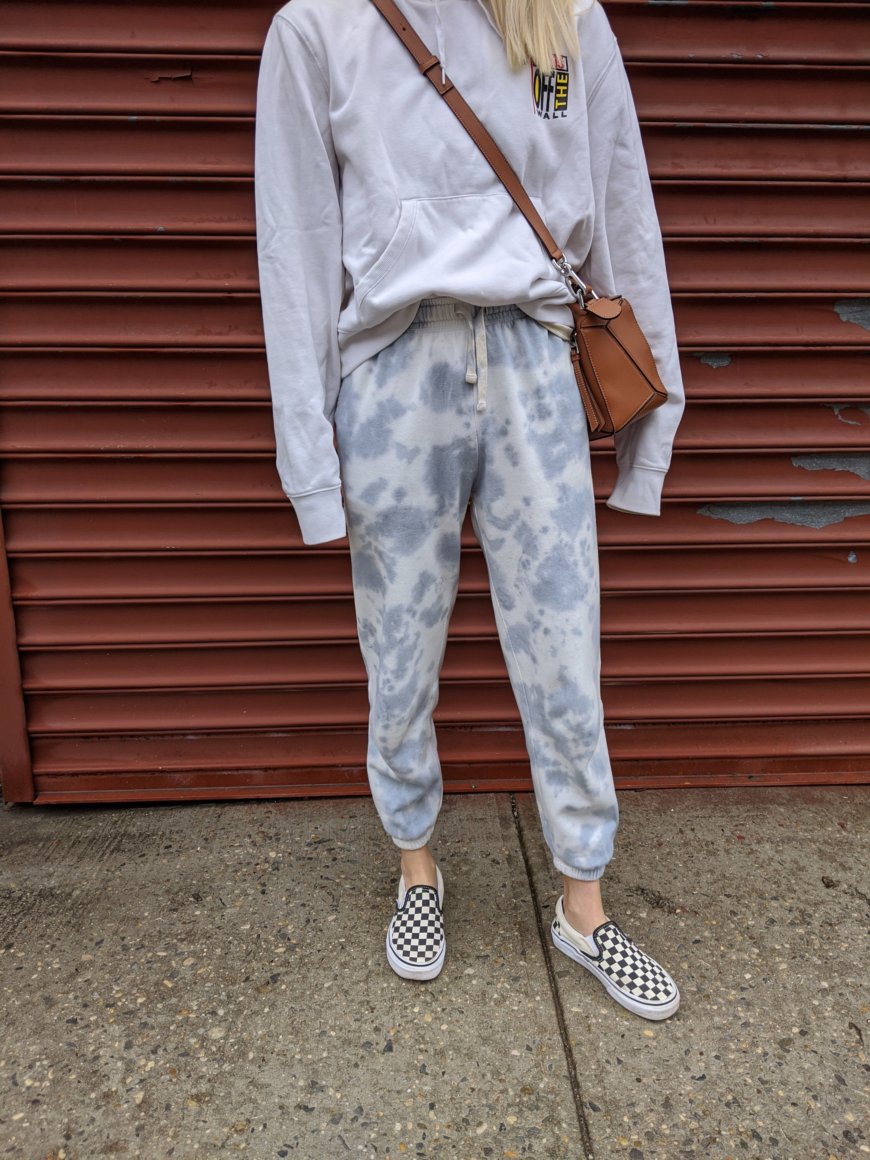 buzzfeed editor in light and medium blue tie-dye sweatpant joggers with a waist tie