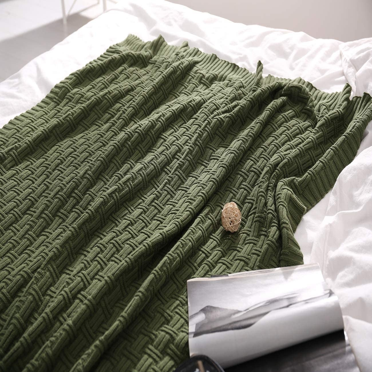 Knit pattern throw on unmade bed