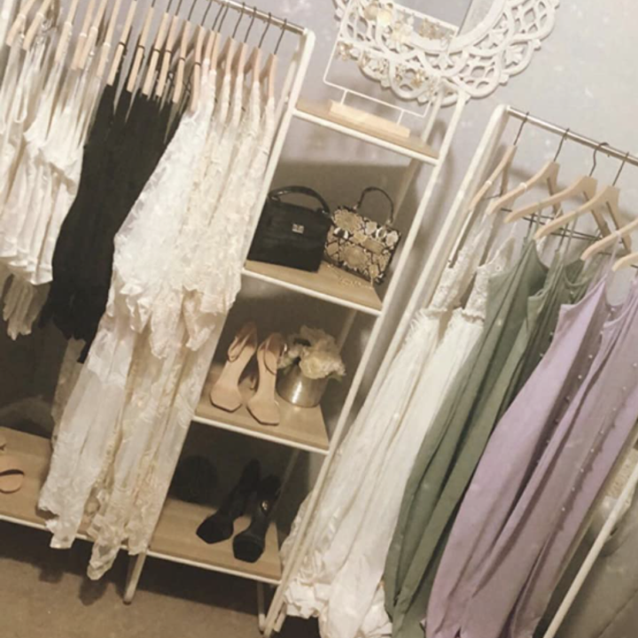 A reviewer's racks with garments and shoes