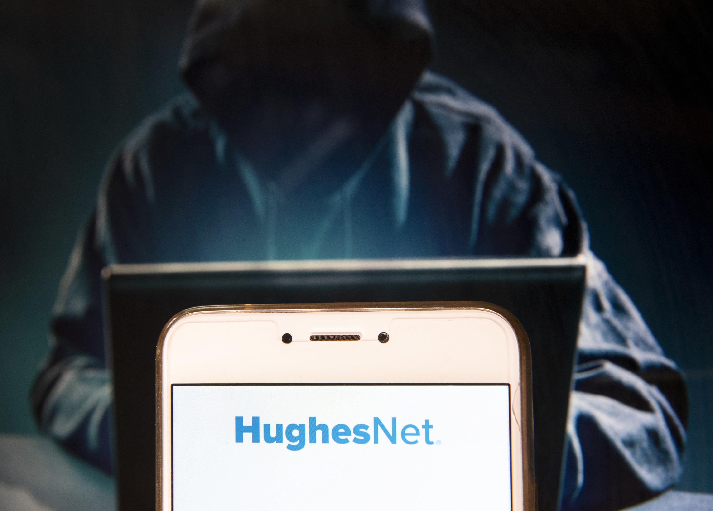 A smartphone showing the HughesNet logo