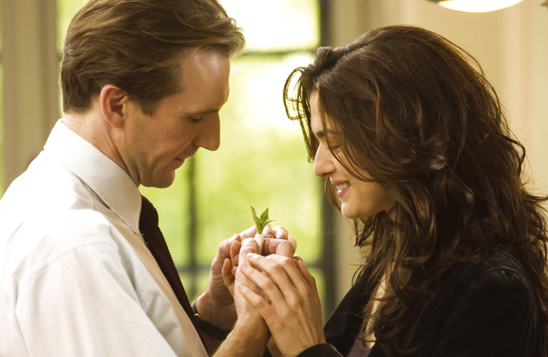Ralph Fiennes and Rachel Weisz holding hands in a scene from The Constant Gardener