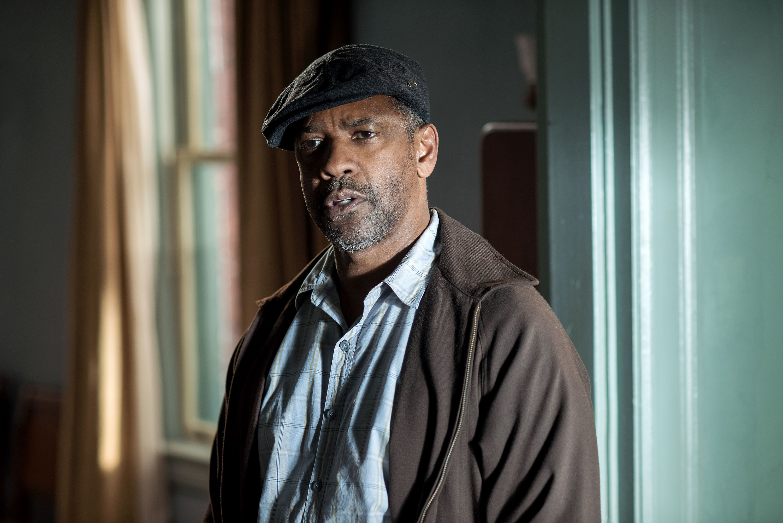 Denzel Washington standing inside a house