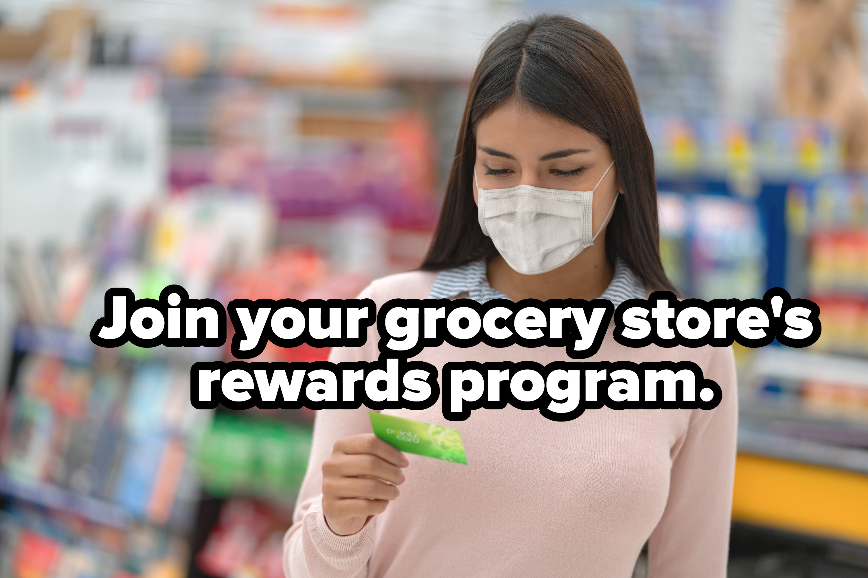 Woman using rewards card at the grocery store
