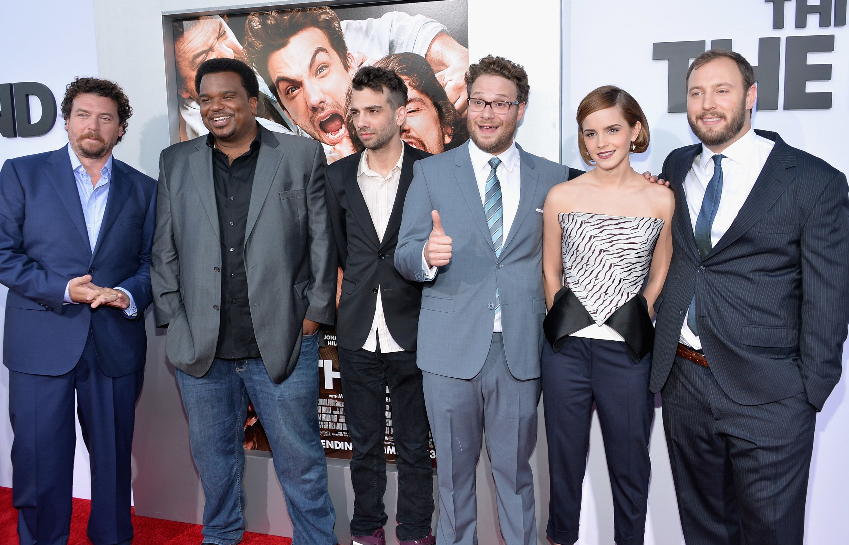 Emma poses with Seth and the rest of the cast at the premiere