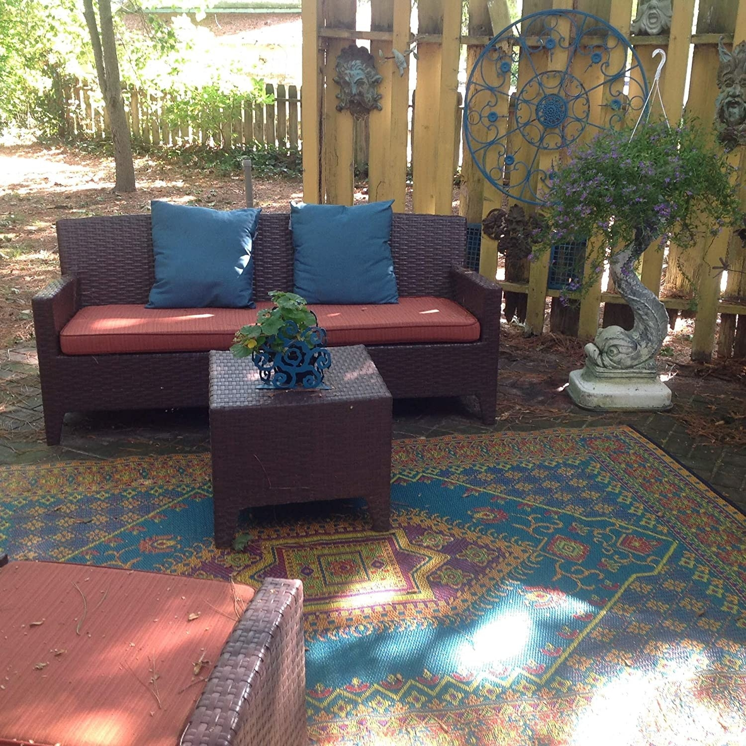 outdoor room with patio furniture with printed rug on the patio surface