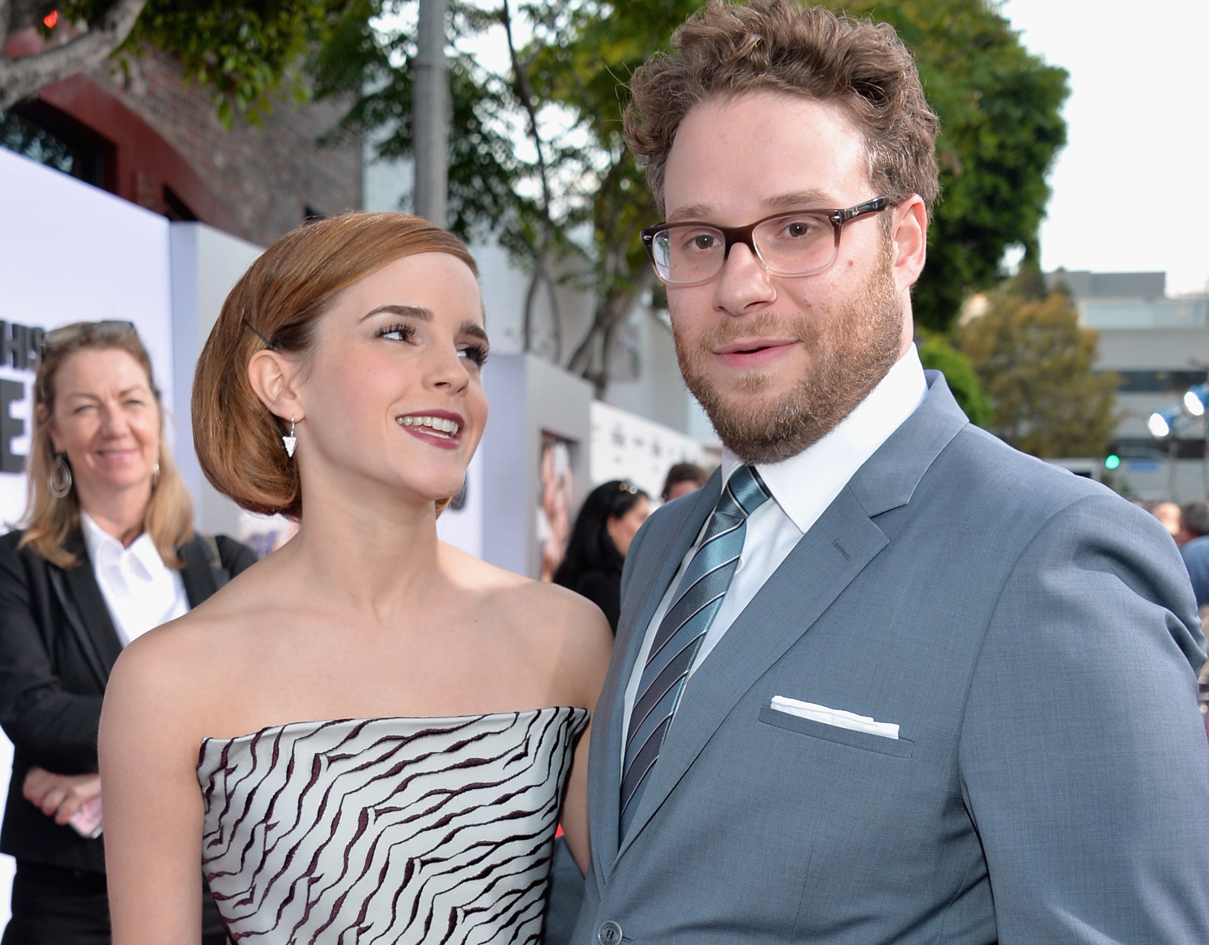 Emma looks up at Seth at the premiere
