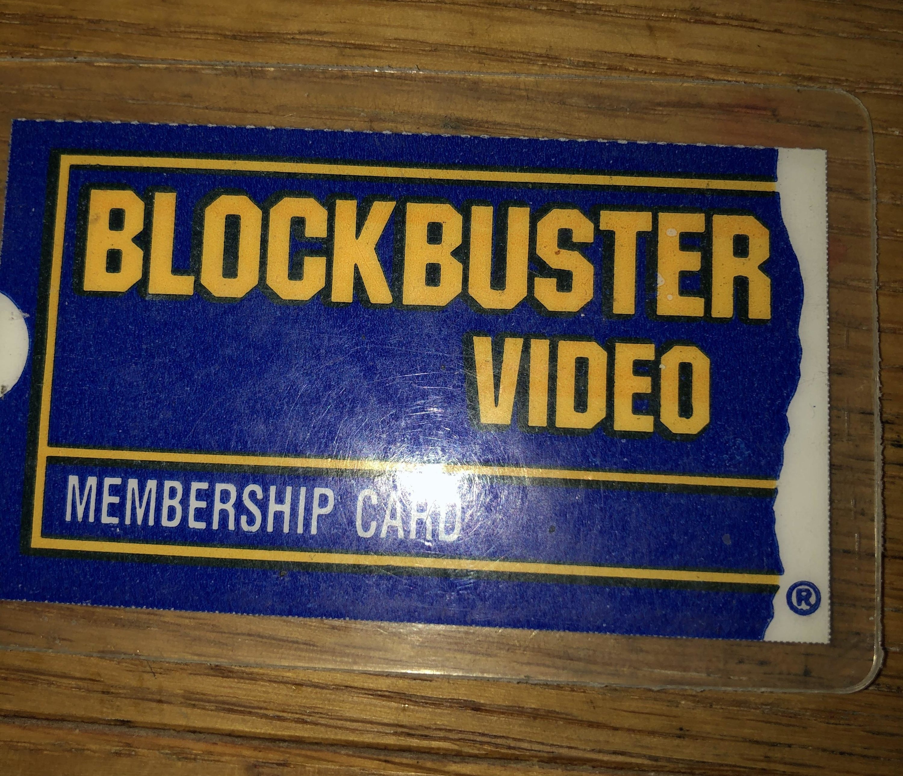 A Blockbuster Video card on a wooden table