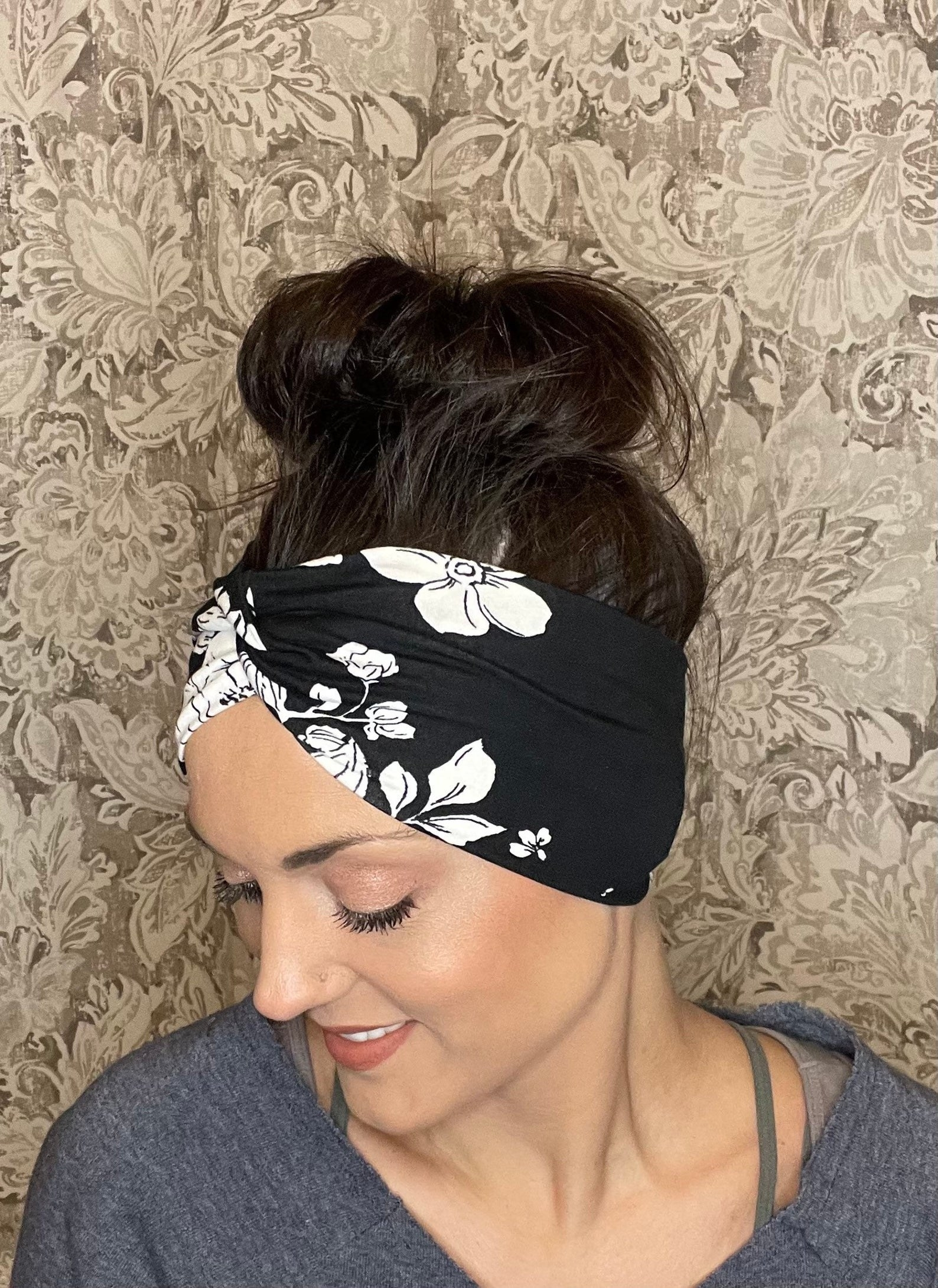 Model wearing black-and-white floral headband
