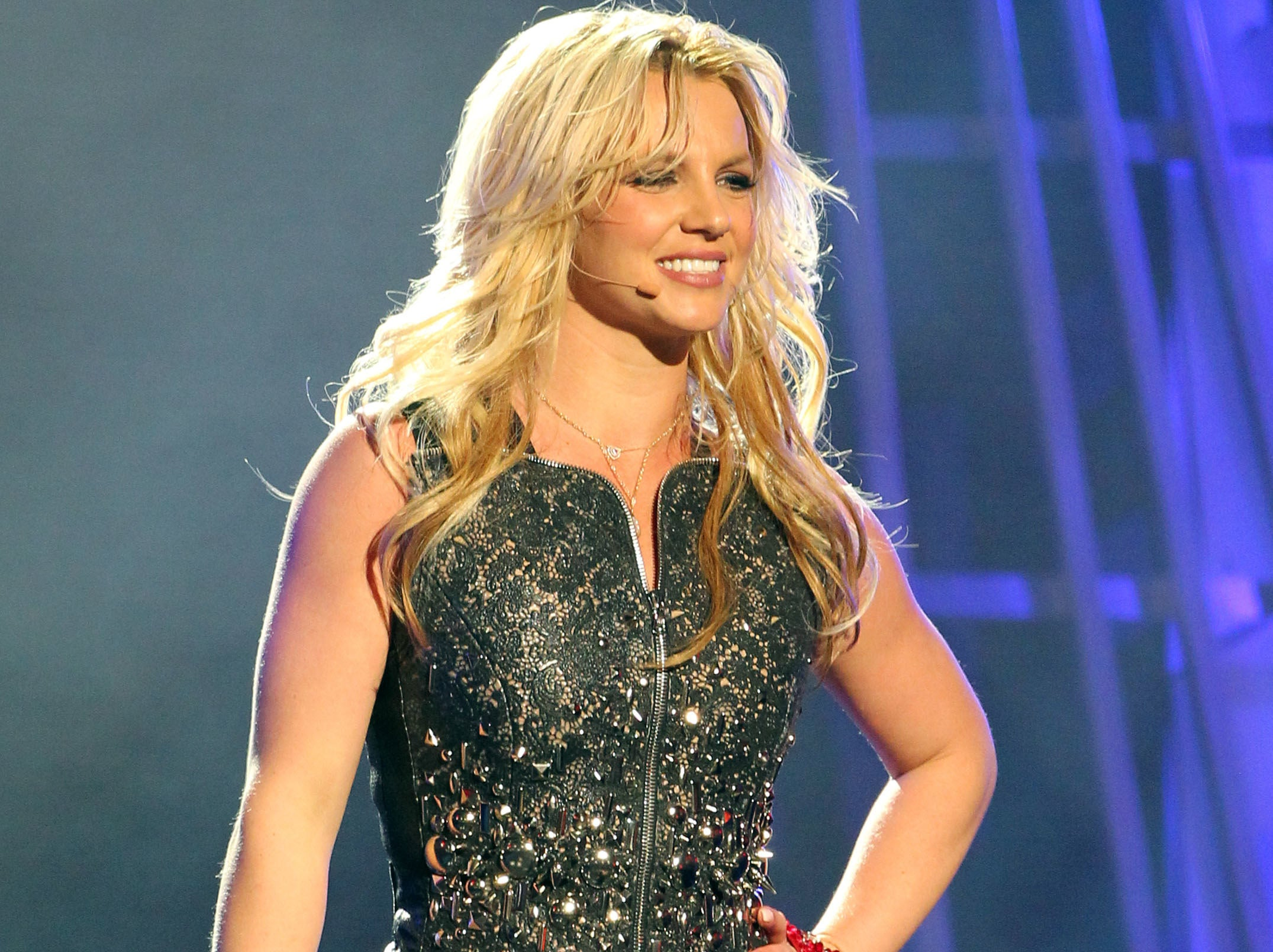 Britney smiles while dancing onstage during a concert
