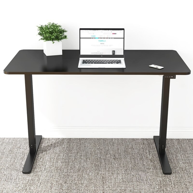 Black standing desk with two legs and electric control