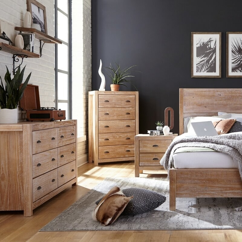 Wooden dressers, nightstand, and bed frame set with bronze hardware