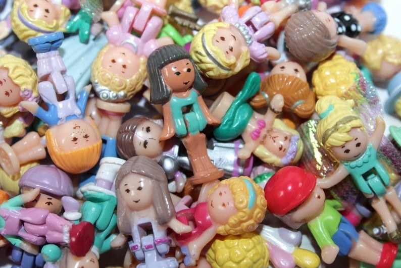 A pile of Polly Pocket dolls