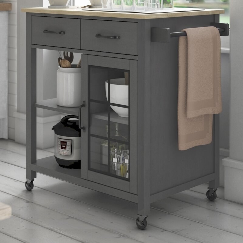 Gray rolling kitchen island with two drawers, open shelving, and cabinet