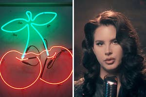 A neon cherry shaped sign hangs on the wall and Lana Del Ray looks into the camera as she sings.