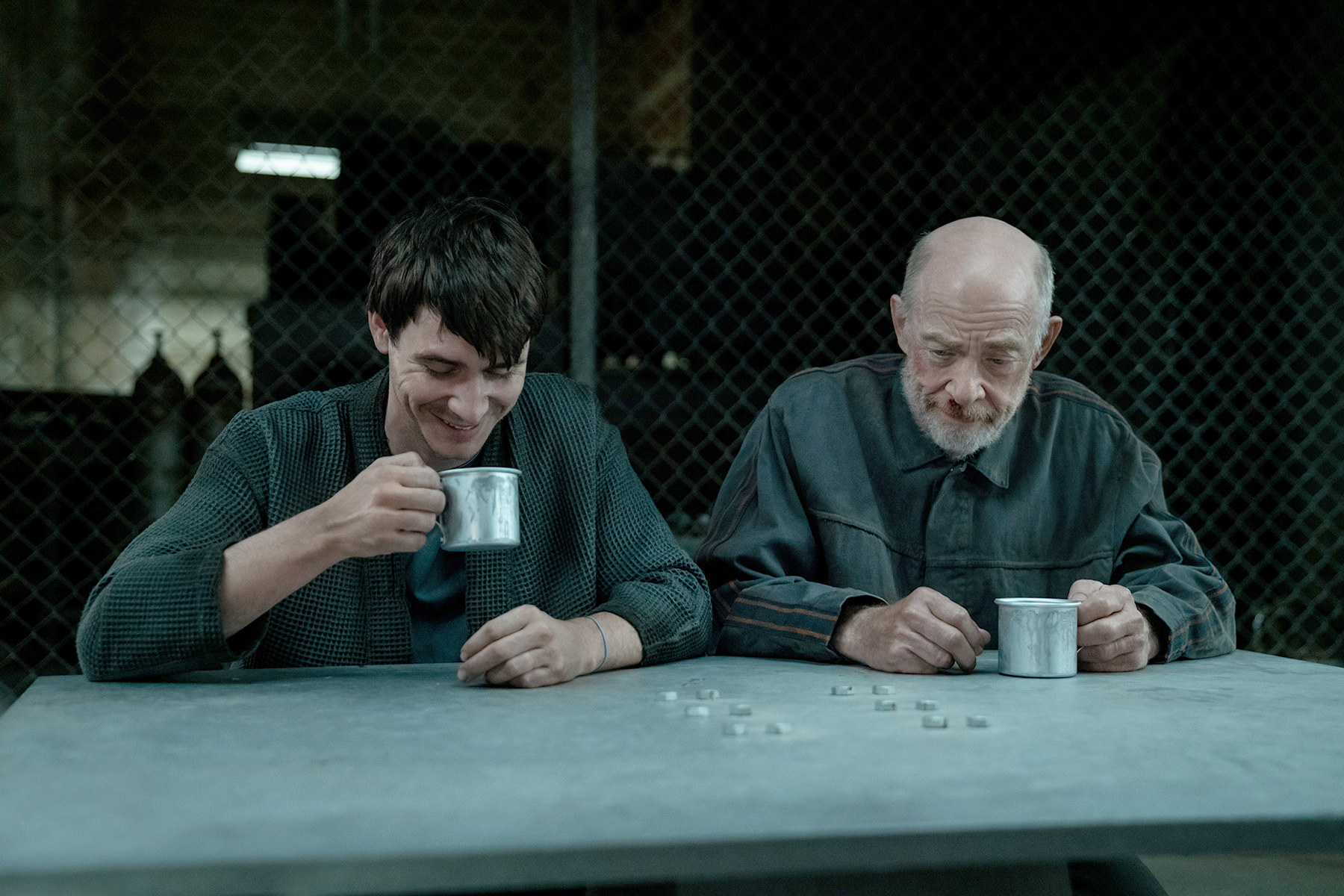 two men drinking together