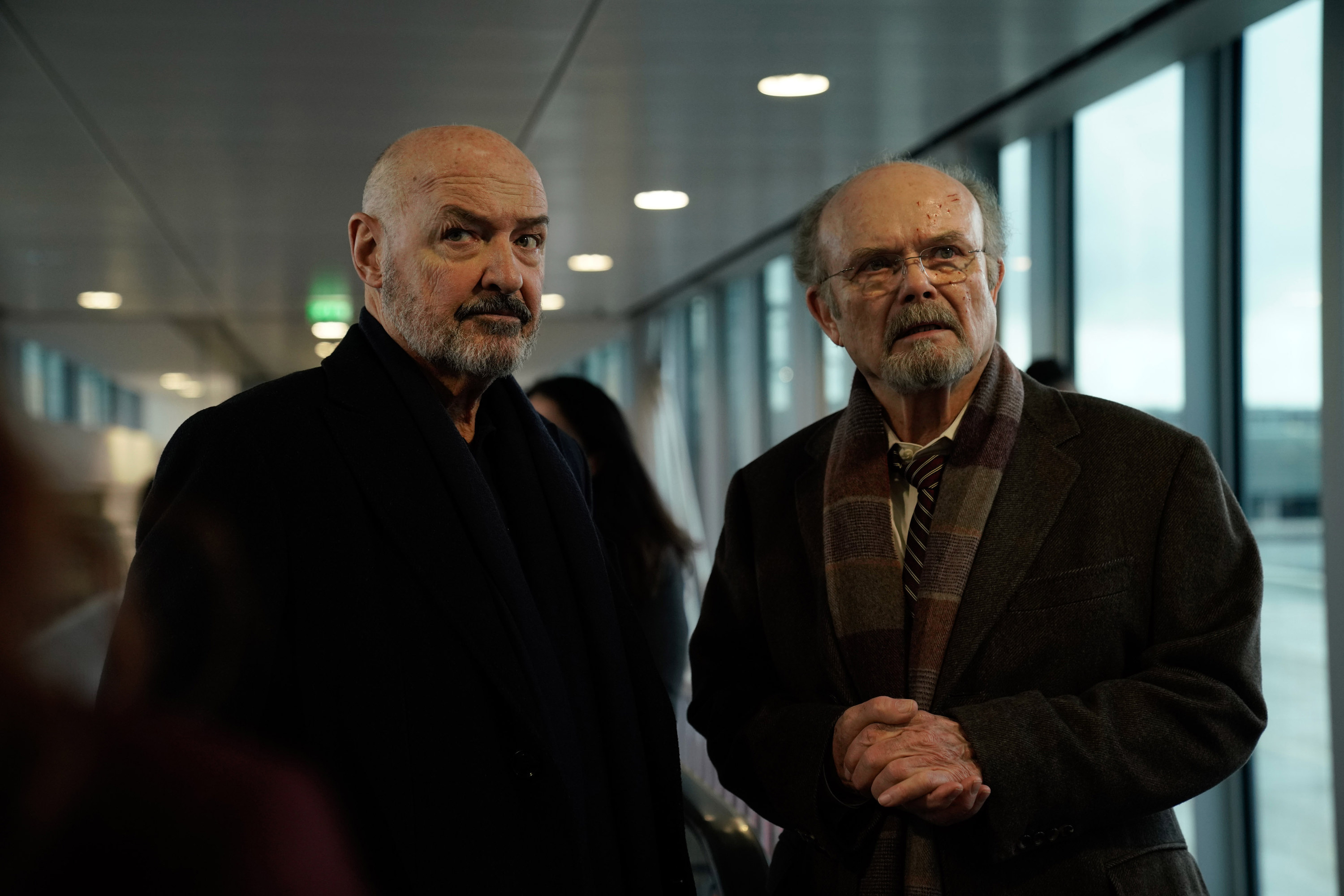 two men in an airport