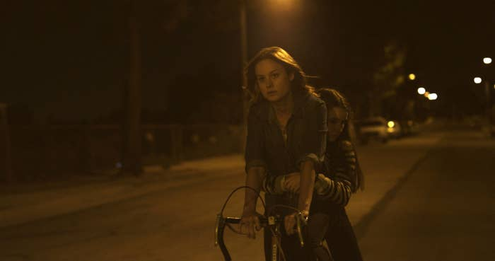 Brie Larson, Kaitlyn Dever riding a bike at night in Short Term 12