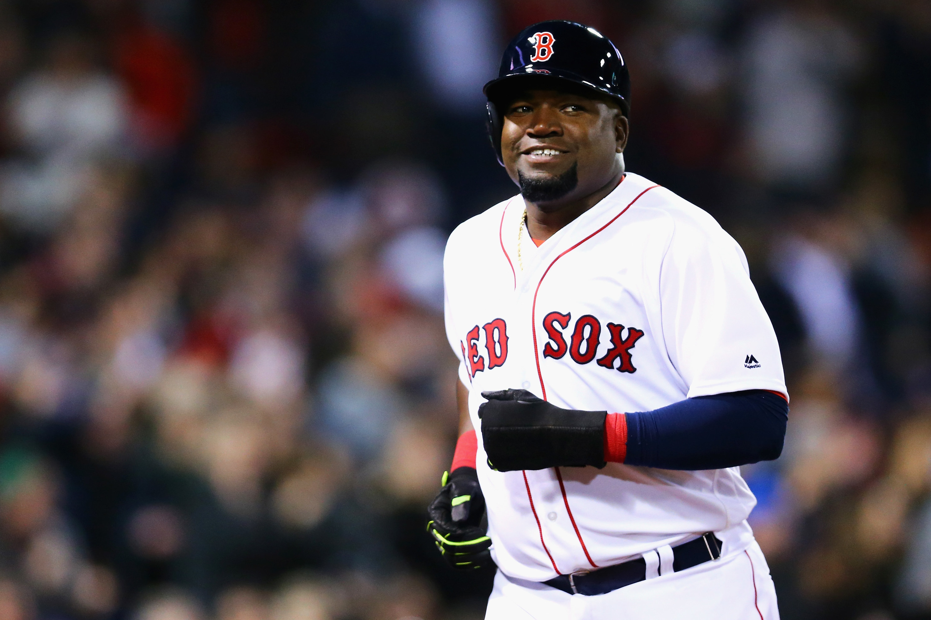 Red Sox player David Ortiz rounding the bases with a smile