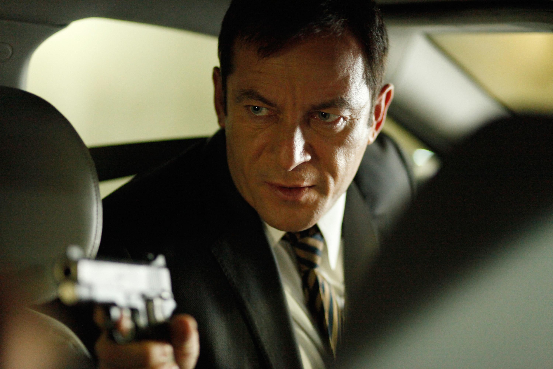 jason isaacs holding a gun