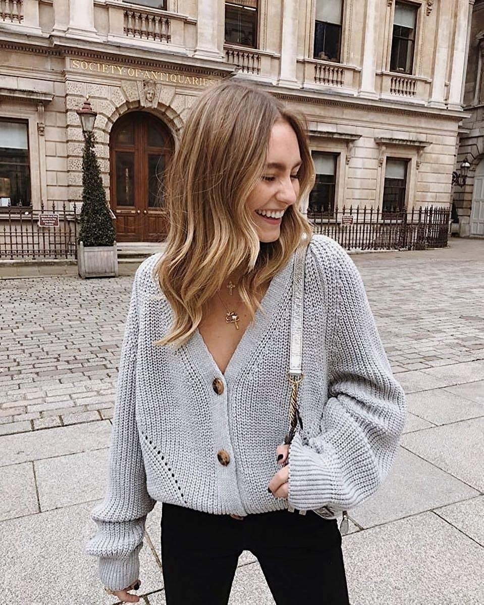 reviewer wearing the slouchy gray cardigan