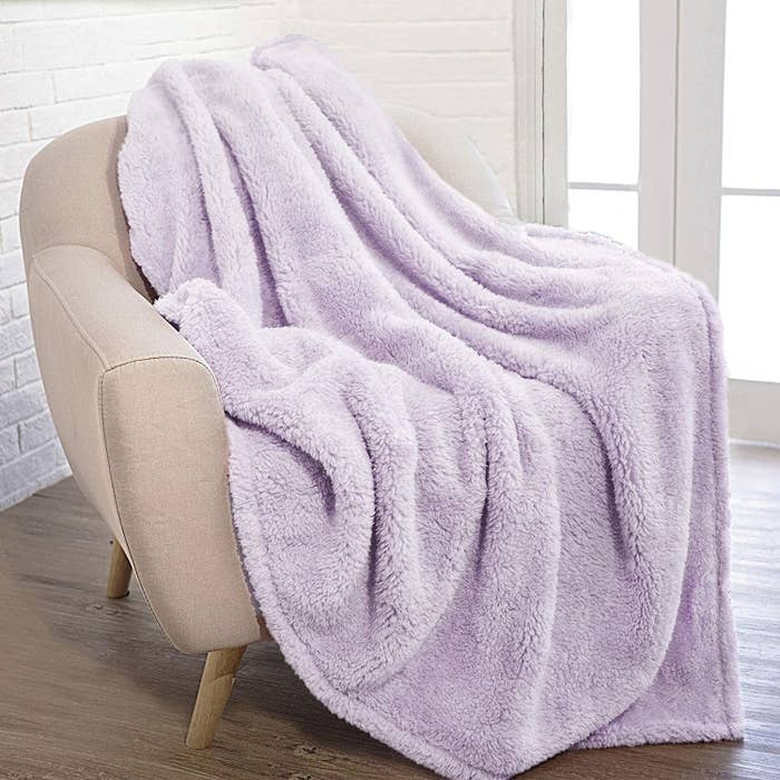 a light purple blanket tossed on a chair