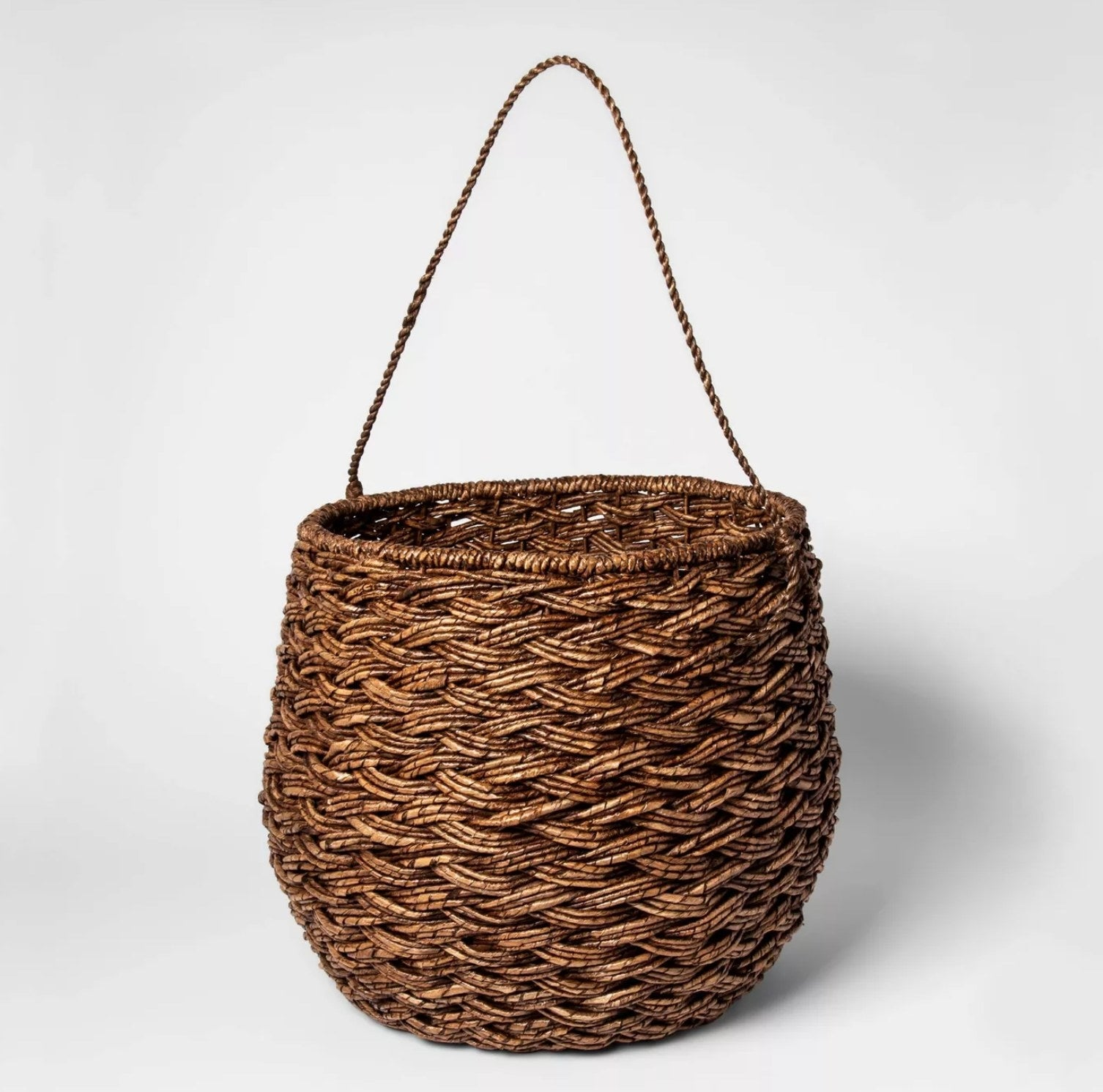 The rounded brown wooven basket