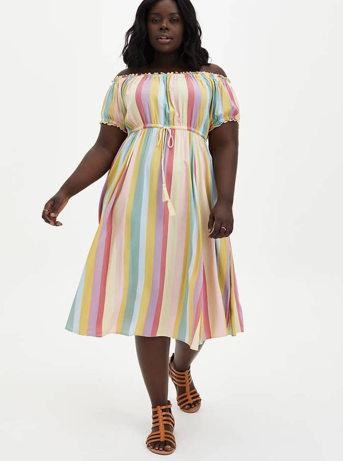 model wearing striped dress with sandals