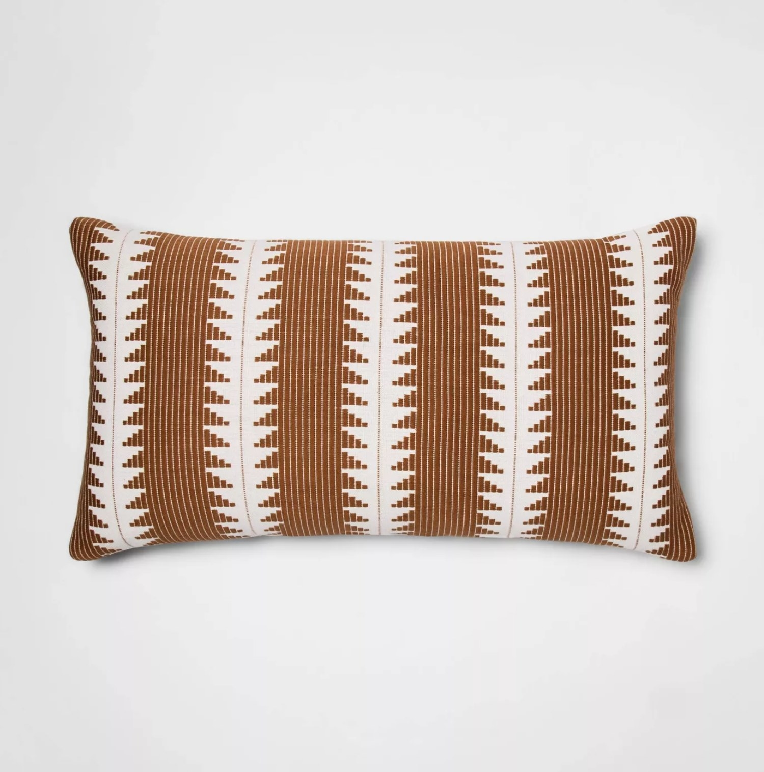 The pillow in tan with white stripes
