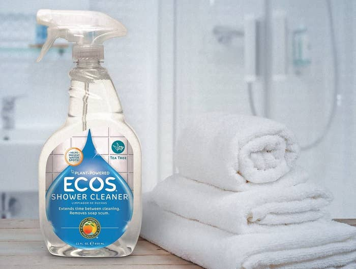 bottle of ecos shower cleaner on bathroom counter next to towels
