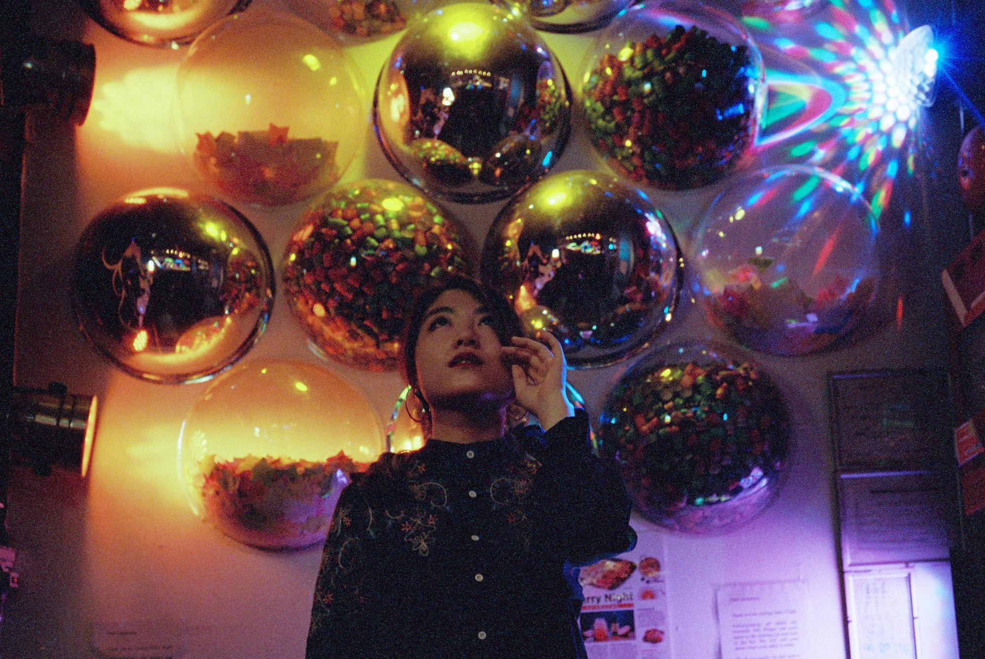 A woman looking up at balloons