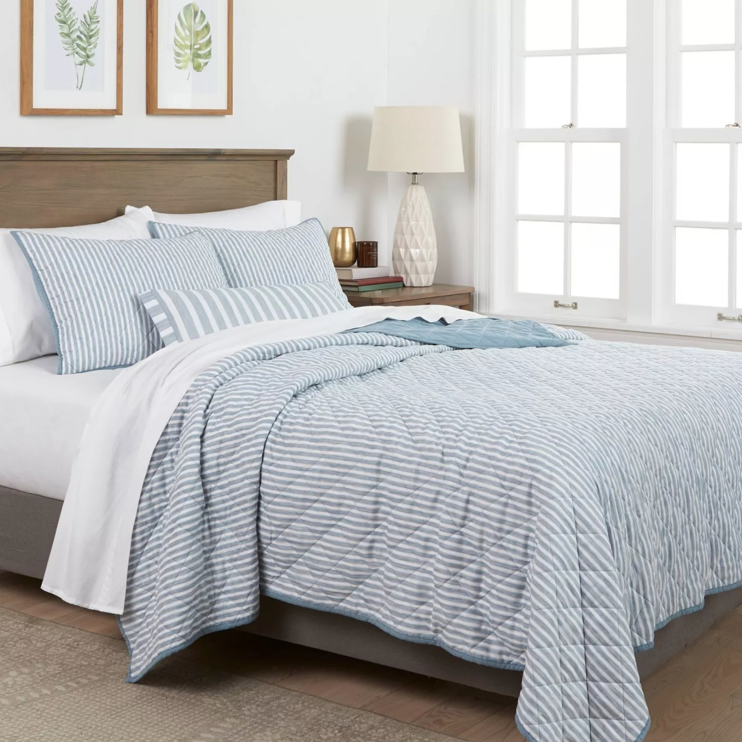 The set in blue with white stripes on a bed